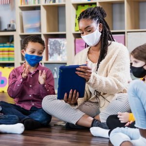 Teacher safely educating students with hybrid learning